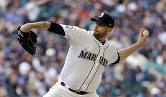 Seattle Mariners starting pitcher James Paxton throws against the Houston Astros in the first inning of a baseball game, Monday, April 10, 2017, in Seattle. The game is the home opener for the Mariners. (AP Photo/Elaine Thompson)