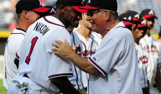 FILE - In this Aug. 13, 2011 file photo, former Atlanta Braves player Otis Nixon, left, is greeted by former Braves manager Bobby Cox during a Braves Legends Game featuring the 1991 Braves against all other Braves alumni in Atlanta, before a baseball game against the Chicago Cubs. Police in Georgia are looking for Nixon, who disappeared over the weekend. In a Facebook post, the Woodstock Police Department says Nixon, who's 58, was last seen leaving his home in the morning on Saturday, April 8, 2017 in a gray Range Rover. Police say he was on his way to a local golf course but never arrived. (AP Photo/Dave Tulis, File)