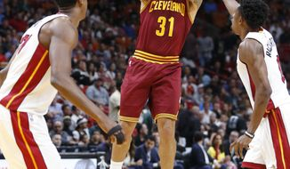 Cleveland Cavaliers guard Deron Williams (31) goes up for a shot against Miami Heat center Hassan Whiteside, left, and guard Josh Richardson during the first half of an NBA basketball game, Monday, April 10, 2017, in Miami. (AP Photo/Wilfredo Lee)