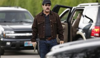 """In this March, 21, 2017 photo, Mexican actor Marco de la O plays drug trafficker Joaquin Guzman during the filming of """"El Chapo"""" in Tabio, Colombia. The life of the Mexican drug kingpin is being brought to television screens in a drama co-produced by Netflix and Univision. (AP Photo/Fernando Vergara)"""