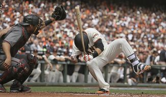 San Francisco Giants' Buster Posey, right, goes falling after getting hit by Arizona Diamondbacks starting pitcher Taijuan Walker in the first inning of a baseball game, Monday, April 10, 2017, in San Francisco. At left is Arizona Diamondbacks catcher Jeff Mathis. Posey was taken out of the game after being hit. (AP Photo/Eric Risberg)