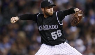 Colorado Rockies relief pitcher Greg Holland delivers a pitch to a Los Angeles Dodgers batter during the ninth inning of a baseball game Saturday, April 8, 2017, in Denver. The Rockies won 4-2. (AP Photo/David Zalubowski)