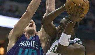 Milwaukee Bucks' Thon Maker is fouled by Charlotte Hornets' Cody Zeller during the second half of an NBA basketball game Monday, April 10, 2017, in Milwaukee. (AP Photo/Tom Lynn)