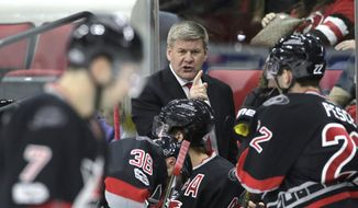 FILE - In this March 3, 2017, file photo, Carolina Hurricanes coach Bill Peters directs his team during the first period of an NHL hockey game against the Arizona Coyotes, in Raleigh, N.C. The longest active playoff drought in the NHL now belongs to the Hurricanes, at eight years and counting.  (AP Photo/Gerry Broome, File)