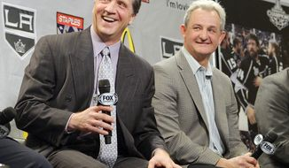 This Jan. 10, 2013 file photo shows Los Angeles Kings president and general manager Dean Lombardi and head coach Darryl Sutter laughing during a news conference to help kick off the NHL hockey team's season in Los Angeles. The Kings have fired Sutter and Lombardi, who led the franchise to its only two Stanley Cup championships. On Monday, April 10, 2017, the team also promoted former defenseman Rob Blake to vice president and general manager, while longtime executive Luc Robitaille will be their new team president in charge of all hockey and business operations. (AP Photo/Mark J. Terrill, file)