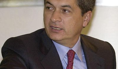 FILE - In this Friday, Aug. 8, 2003 file photo, former Tamaulipas state Governor Tomas Yarrington participates in the XXIth Border Governors Conference in Chihuahua, Mexico. Mexican prosecutors said April 9, 2017, that the ex-governor accused in Mexico of money laundering and organized crime, has been detained in Italy. He is also wanted in the United States for allegedly receiving millions of dollars in bribes from the Gulf cartel during his 1999 to 2004 term. (AP Photo/Jaime Puebla, File)
