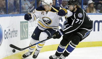 Buffalo Sabres center Jack Eichel (15) and Tampa Bay Lightning defenseman Victor Hedman (77) battle for control of the puck during the first period of an NHL hockey game, Sunday, April 9, 2017, in Tampa, Fla. (AP Photo/Chris O'Meara)