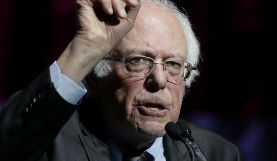 Sen. Bernie Sanders, I-Vt., addresses an audience during a rally Friday, March 31, 2017, in Boston. Sanders and Sen. Elizabeth Warren, D-Mass., made a joint appearance at the evening rally in Boston as liberals continue to mobilize against the agenda of Republican President Donald Trump. (AP Photo/Steven Senne)