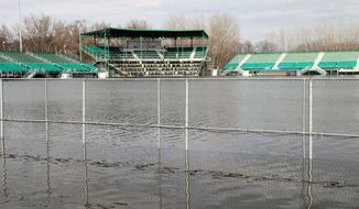 In this Sunday, April 9, 2017, photo, water fills Homer Stryker Field in Kalamazoo, Mich. Flooding in southwestern Michigan has closed several roadways and swamped the home of the Kalamazoo Growlers baseball team while severe thunderstorms caused damage in the Upper Peninsula. (Jake Green/Kalamazoo Gazette-MLive Media Group via AP)
