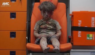 FILE --In this Aug. 17, 2016 file frame grab taken from video provided by the Syrian anti-government activist group Aleppo Media Center (AMC), 5-year-old Omran Daqneesh sits in an ambulance after being pulled out of a building hit by an airstrike in Aleppo, Syria. With its missile strike on Shayrat Airbase in central Syria, Washington signaled that it had judged President Bashar Assad responsible for the horrific chemical weapons attack in north Syria that drew international outrage last week. But it is not the first or even deadliest atrocity of the war.  (Aleppo Media Center via AP, File)