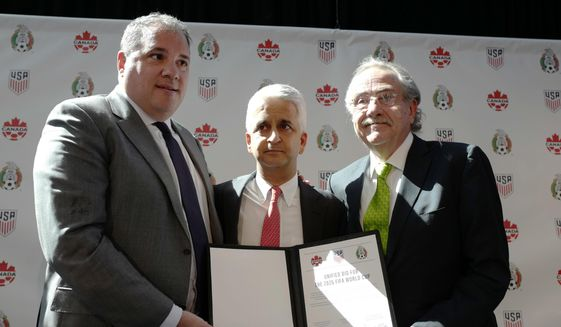 Victor Montagliani, left, President of the Canadian Soccer Association, Sunil Gulati, center, President of the United States Soccer Federation, and Decio de Maria, President of the Mexican Football Federation, show their unified bid to co-host the 2026 World Cup, Monday, April 10, 2017, in New York. (AP Photo/Mark Lennihan)