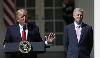 Supreme Court Justice Neil Gorsuch listens as President Donald Trump speaks in the Rose Garden of the White House White House in Washington, Monday, April 10, 2017, before a public swearing-in ceremony for Gorsuch. (AP Photo/Carolyn Kaster)