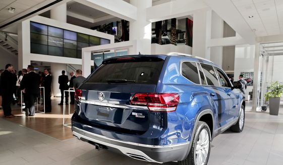 The 2018 Volkswagen Atlas sits on the showroom floor at the company's New York flagship store during a media preview for the New York International Auto Show, Tuesday, April 11, 2017, in New York. (AP Photo/Julie Jacobson)