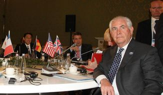 U.S. Secretary of State Rex Tillerson sits at the table during a meeting of foreign ministers of the G7 in Lucca, Italy, Tuesday, April 11, 2017. Foreign ministers from the Group of Seven industrialized nations are expected to call for a new international push to end the war in Syria as they end a meeting in Italy Tuesday.  (Riccardo Dalle Luche/ANSA via AP)