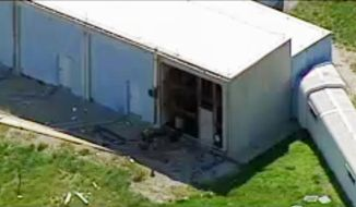 This photo from video by KCTV5 shows damage to the side of a building in the aftermath of a fatal explosion at the Lake City Army Ammunition Plant in Independence, Mo., Tuesday, April 11, 2017.  (KCTV5 via AP)