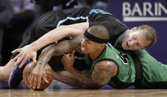 Charlotte Hornets' Cody Zeller, top, and Boston Celtics' Isaiah Thomas, bottom, vie for a loose ball in the second half of an NBA basketball game in Charlotte, N.C., Saturday, April 8, 2017. The Celtics won 121-114. (AP Photo/Chuck Burton)