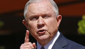 Attorney General Jeff Sessions speaks at a news conference after touring the U.S.-Mexico border with border officials, Tuesday, April 11, 2017, in Nogales, Ariz. Sessions announced making immigration enforcement a key Justice Department priority, saying he will speed up deportations of immigrants in the country illegally who were convicted of federal crimes. (AP Photo/Ross D. Franklin)