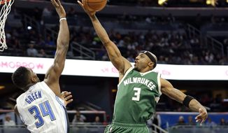 FILE - In this Jan. 20, 2017, file photo, Orlando Magic's Jeff Green (34) blocks a shot by Milwaukee Bucks' Jason Terry (3) during the first half of an NBA basketball game, in Orlando, Fla. Terry's streak of postseason appearances has reached 12 years. He's a veteran presence who will come in handy in the postseason for the young Bucks. (AP Photo/John Raoux, File)