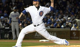 Chicago Cubs starting pitcher Jon Lester (34) throws against the Los Angeles Dodgers during the first inning of a baseball game on a home opening day, Monday, April 10, 2017, in Chicago. (AP Photo/David Banks)