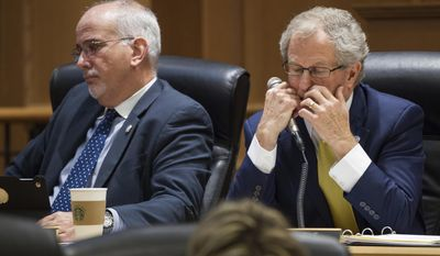 Rep. Mark White, R-Memphis, right, Rep. Roger Kane, R-Knoxville, listen to the debate over a bill seeking offer in-state tuition rates to public college students whose parents brought them to the country illegally in Nashville, Tenn., on Tuesday, April 11, 2017. The measure was narrowly defeated in the House Education Administration and Planning Committee. White, the sponsor of the bill, voted for the measure, while Kane voted against. (AP Photo/Erik Schelzig)