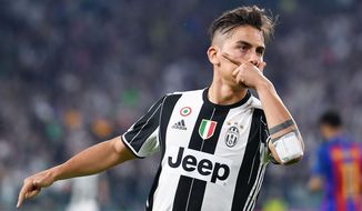 Juventus' Paulo Dybala celebrates after scoring during a Champions League, quarterfinal, first-leg soccer match between Juventus and Barcelona, at the Juventus Stdium in Turin, Italy, Tuesday, April 11, 2017. (Alessandro Di Marco/ANSA via AP)