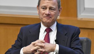 "FILE- In this Feb. 1, 2017, file photo, U.S. Supreme Court Chief Justice John Roberts prepares to speak at the The John G. Heyburn II Initiative and University of Kentucky College of Law's judicial conference and speaker series in Lexington, Ky. Roberts said Tuesday, April 11, that the ""partisan hostility"" surrounding the confirmation of Justice Neil Gorsuch is of concern because it could undermine public confidence in the apolitical nature of the judicial system. (AP Photo/Timothy D. Easley, File)"