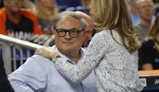 "Miami Marlins owner and CEO Jeffrey Loria and his wife Julie Lavin Loria, wait for the start of a baseball game between the Marlins and the Atlanta Braves, Tuesday, April 11, 2017, in Miami. Hours before the Marlins' home opener Tuesday, Marlins president David Samson said talks with multiple parties interested in buying the team are in the ""fourth inning,"" leaving lots of uncertainty about the future of the franchise. (AP Photo/Wilfredo Lee)"