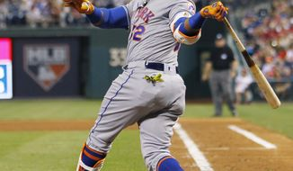New York Mets' Yoenis Cespedes follows through on his third home run of the night, in the fifth inning of the team's baseball game against the Philadelphia Phillies, Tuesday, April 11, 2017, in Philadelphia. (AP Photo/Laurence Kesterson)