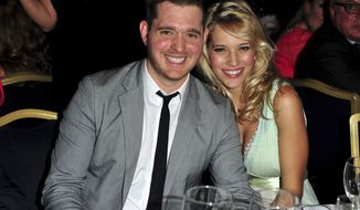 "FILE - In this June 29, 2012, file photo, singer Michael Buble and his wife, Argentine TV actress Luisana Lopilato, pose at the Nordoff Robbins 02 Silver Clef Awards at London Hilton, in London. Lopilato says her and Buble's son Noah is doing ""well"" following successful cancer treatment. (Photo by Jon Furniss/Invision/AP, File)"
