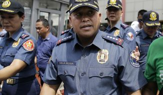 Philippine National Police Chief Ronald dela Rosa walks after an anti-terror simulation exercise at a bus terminal in Quezon city, north of Manila, Philippines on Tuesday, April 11, 2017. Dela Rosa said at least several people have been killed in battle between government forces and suspected Abu Sayyaf militants on a central resort island, far from the extremists' southern jungle bases and in a region where the U.S. government has warned the gunmen may be conducting kidnappings. (AP Photo/Aaron Favila)
