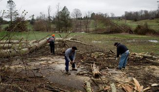 Severe weather damage off of 92nd Street between Wingeier Avenue and Hastings Road in Alto, Mich., on Tuesday, April 11, 2017. Authorities say severe thunderstorms Monday night spawned a suspected tornado in western Michigan, knocking down a barn and blocking roadways with debris. (Neil Blake/The Grand Rapids Press via AP)