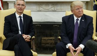 President Donald Trump meets with NATO Secretary General Jens Stoltenberg in the Oval Office of the White House in Washington, Wednesday, April 12, 2017. (AP Photo/Evan Vucci)
