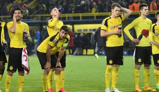 Dortmund's Nuri Sahin, Sokratis Papastathopoulos, Lukasz Piszczek, Matthias Ginter and Julian Weigl, from left, react after losing 2-3 during the Champions League quarterfinal first leg soccer match between Borussia Dortmund and AS Monaco in Dortmund, Germany, Wednesday, April 12, 2017. (AP Photo/Martin Meissner)