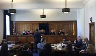 Bernalillo County District Attorney Raul Torrez fields questions from the New Mexico Supreme Court in Santa Fe, N.M., on Wednesday, April 12, 2017. Prosecutors and public defenders are turning to the high court for guidance on how to apply new constitutional provisions that can keep suspects jailed without bond until trial. Justices heard arguments Wednesday aimed at clarifying what evidence must be presented at the suspects' detention hearings. Torrez says his requests for no-bond detentions are being unfairly dismissed. (AP Photo/Morgan Lee)