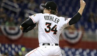Miami Marlins starting pitcher Tom Koehler (34) throws during the first inning of a baseball game against the Atlanta Braves, Wednesday, April 12, 2017, in Miami. (AP Photo/Lynne Sladky)