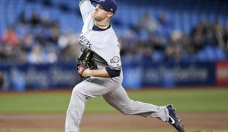 Milwaukee Brewers starting pitcher Chase Anderson (57) throws against the Toronto Blue Jays during the first inning of a baseball game in Toronto, Wednesday, April 12, 2017. (Frank Gunn/The Canadian Press via AP)