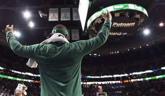 Boston Celtics guard Isaiah Thomas celebrates from the bench late in the fourth quarter during an NBA basketball game against the Milwaukee Bucks in Boston, Wednesday, April 12, 2017. With the Celtics' regular-season finale 112-94 win, they claim the No. 1 seed in the Eastern Conference playoffs. (AP Photo/Charles Krupa)