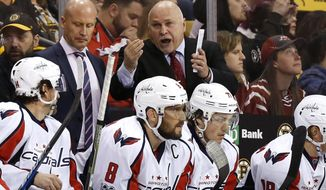 Washington Capitals coach Barry Trotz talks to his players during the third period of Washington's 3-1 win over the Boston Bruins in an NHL hockey game in Boston on Saturday, April 8, 2017. (AP Photo/Winslow Townson)