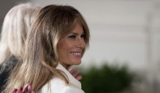 First lady Melania Trump smiles as she is recognized by President Donald Trump as he speaks at a women's empowerment panel in the East Room of the White House in Washington on March 29, 2017. **FILE**