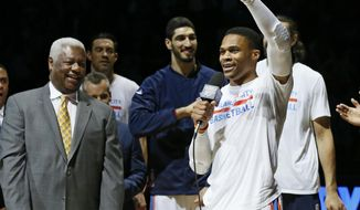 Oklahoma City Thunder guard Russell Westbrook, right, talks to the fans as Oscar Robertson, left, and others listen, before an NBA basketball game between the Denver Nuggets and the Thunder in Oklahoma City, Wednesday, April 12, 2017. (AP Photo/Sue Ogrocki)
