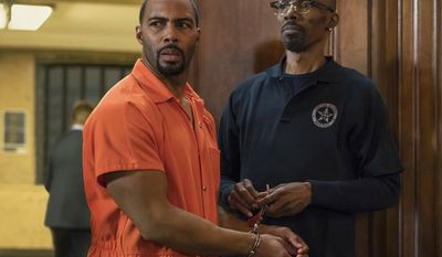 """This image released by Starz shows Omari Hardwick, left, with Charlie Murphy in a scene from the original series, """"Power."""" Murphy, older brother of actor-comedian Eddie Murphy, died Wednesday, April 12, 2017 of leukemia in New York. He was 57.  (Myles Aronowitz/Starz via AP)"""