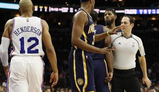 Referee Marat Kogut, right, steps in between Indiana Pacers' Paul George, center right and Philadelphia 76ers' Gerald Henderson, left, after their second altercation, which will lead to both ejections during the second half of an NBA basketball game, Monday, April 10, 2017, in Philadelphia. The Pacers won 120-111. (AP Photo/Chris Szagola)