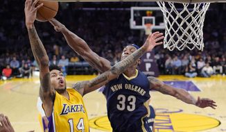Los Angeles Lakers forward Brandon Ingram, left, shoots as New Orleans Pelicans forward Dante Cunningham defends during the first half of an NBA basketball game, Tuesday, April 11, 2017, in Los Angeles. (AP Photo/Mark J. Terrill)