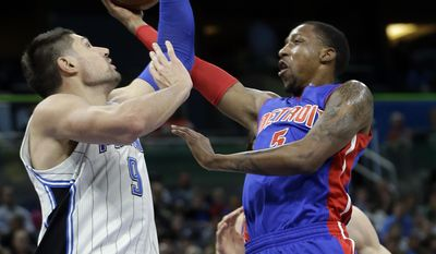 Detroit Pistons' Kentavious Caldwell-Pope, right, goes up for a shot past Orlando Magic's Nikola Vucevic (9) during the first half of an NBA basketball game, Wednesday, April 12, 2017, in Orlando, Fla. (AP Photo/John Raoux)