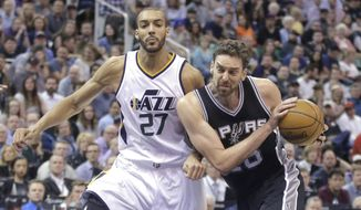San Antonio Spurs center Pau Gasol, right, drives around Utah Jazz center Rudy Gobert (27) during the first half of an NBA basketball game Wednesday, April 12, 2017, in Salt Lake City. (AP Photo/Rick Bowmer)