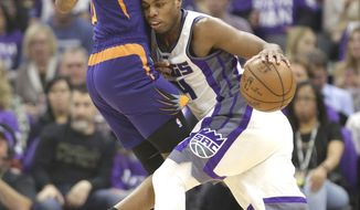 Sacramento Kings guard Buddy Hield, right, runs into Phoenix Suns forward Derrick Jones Jr. during the first half of an NBA basketball game Tuesday, April 11, 2017, in Sacramento, Calif. (AP Photo/Rich Pedroncelli)