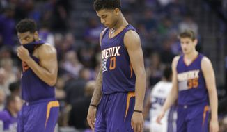 Phoenix Suns forward Marquese Chriss, center, walks off the court during a timeout in the closing moments of the Suns 129-104 loss to the Sacramento Kings during in an NBA basketball game Tuesday, April 11, 2017, in Sacramento, Calif. (AP Photo/Rich Pedroncelli)