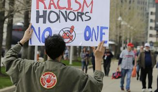 Josh Hunt protests as fans walk to the ballpark before a baseball game, Tuesday between the Chicago White Sox and the Cleveland Indians, April 11, 2017, during opening day in Cleveland. Hunt is from the Cheyenne and Arapaho Tribe. (AP Photo/Tony Dejak)