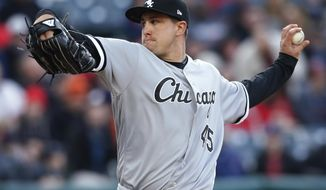 Chicago White Sox starting pitcher Derek Holland winds up during the second inning of the team's baseball game against the Cleveland Indians on Wednesday, April 12, 2017, in Cleveland. (AP Photo/Ron Schwane)