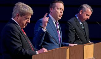 Republican gubernatorial candidate, Corey Stewart (center) gestures during opening statements as State Sen. Frank Wagner, left, and Ed Gillespie listen during a debate at Liberty University in Lynchburg, Virginia on Thursday. Mr. Gillespie is the current leader among the three GOP candidates-- he's polling at 28 percent. (Associated Press)